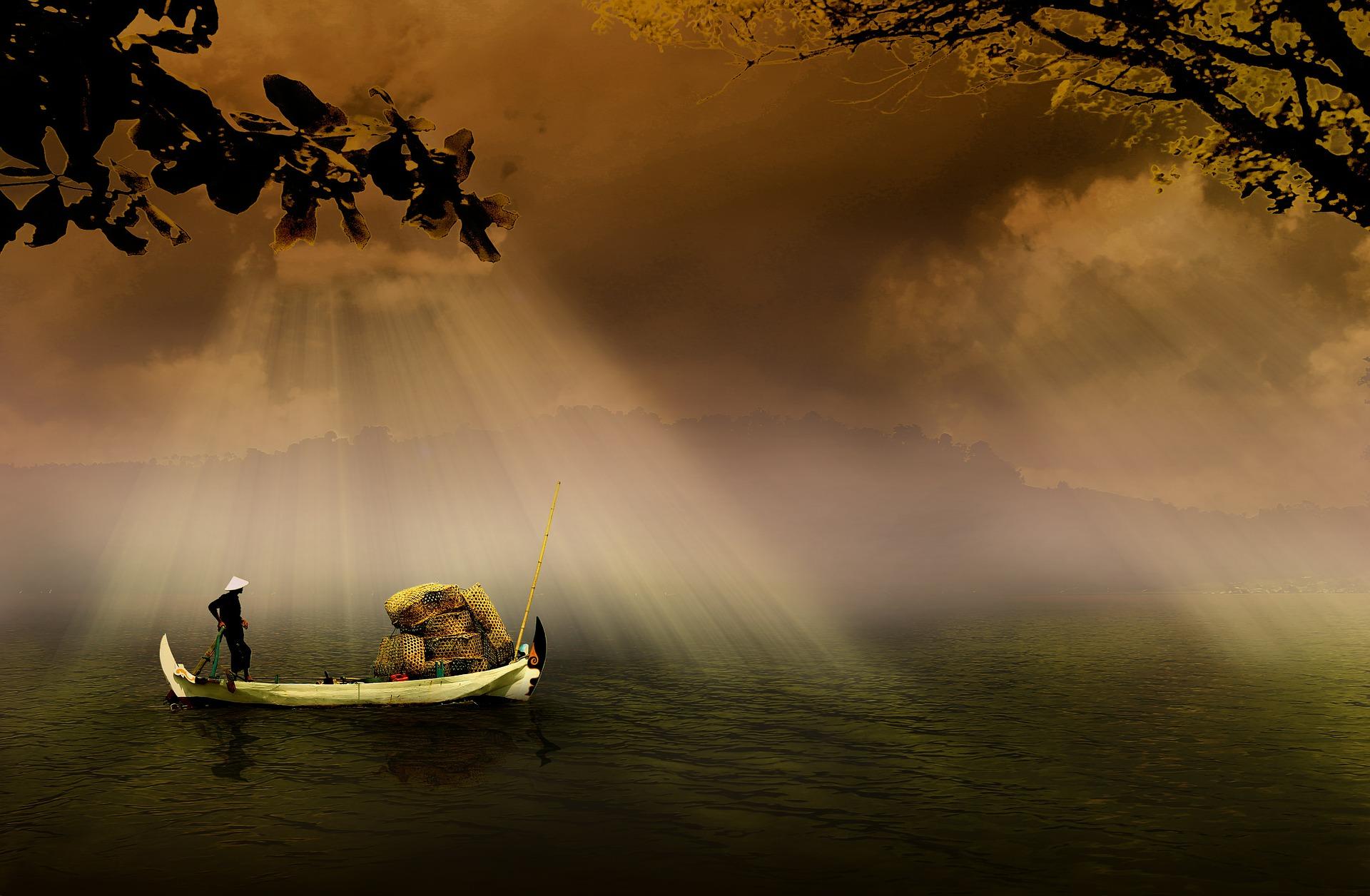 海でボートをのる男性